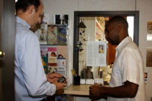 Dr. Mitchell talking with a patient about a nutritional supplement in Raleigh, N.C.