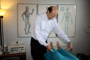 Acupuncture without needles: Dr. Mitchell uses electronic probes to diagnose the body's imbalances as well as to treat the patient.